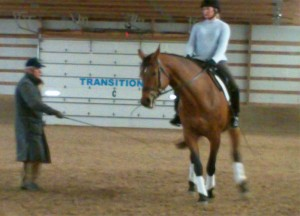Larry assists with the leg yield-on-the-circle exercise