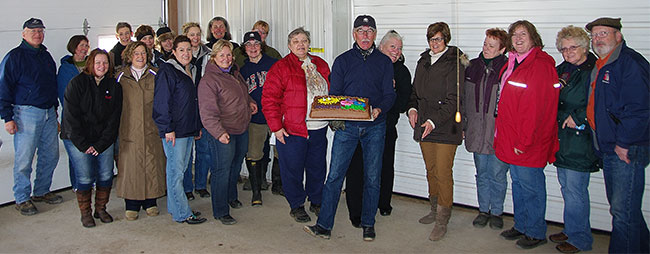 Members of The HUB Club pose with Larry and his cake